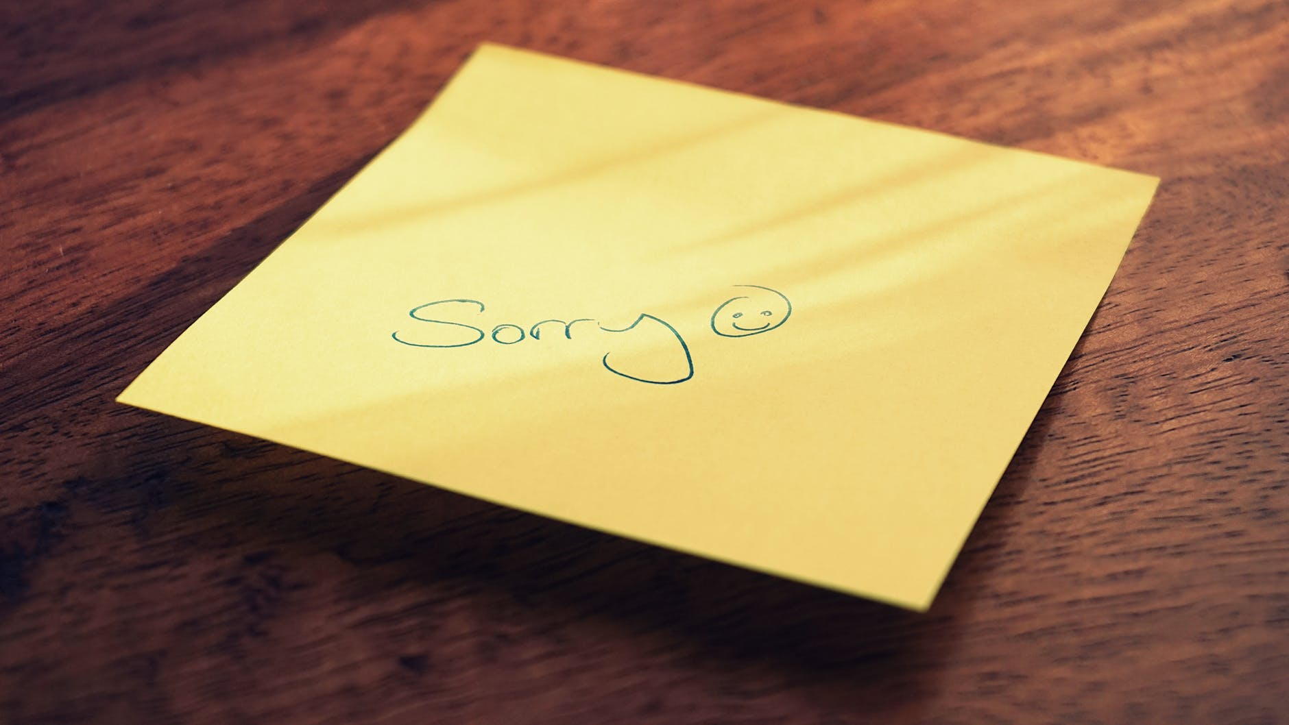 sticky note with apology